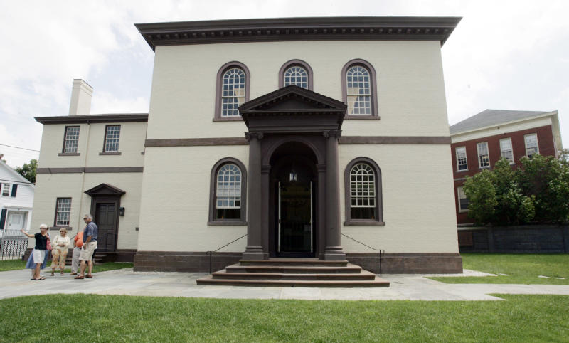 FILE - In this July 30, 2009 file photo, visitors stand outside the Touro Synagogue in Newport, RI., the oldest existing Jewish house of worship in the United States.  A federal judge,  in January 2013, told lawyers for the Touro Synagogue and for Congregation Shearith Israel in New York City, the nation's oldest Jewish congregation, not to speak to the media about lawsuits they've brought against each other.  (AP Photo/Eric J. Shelton, File)