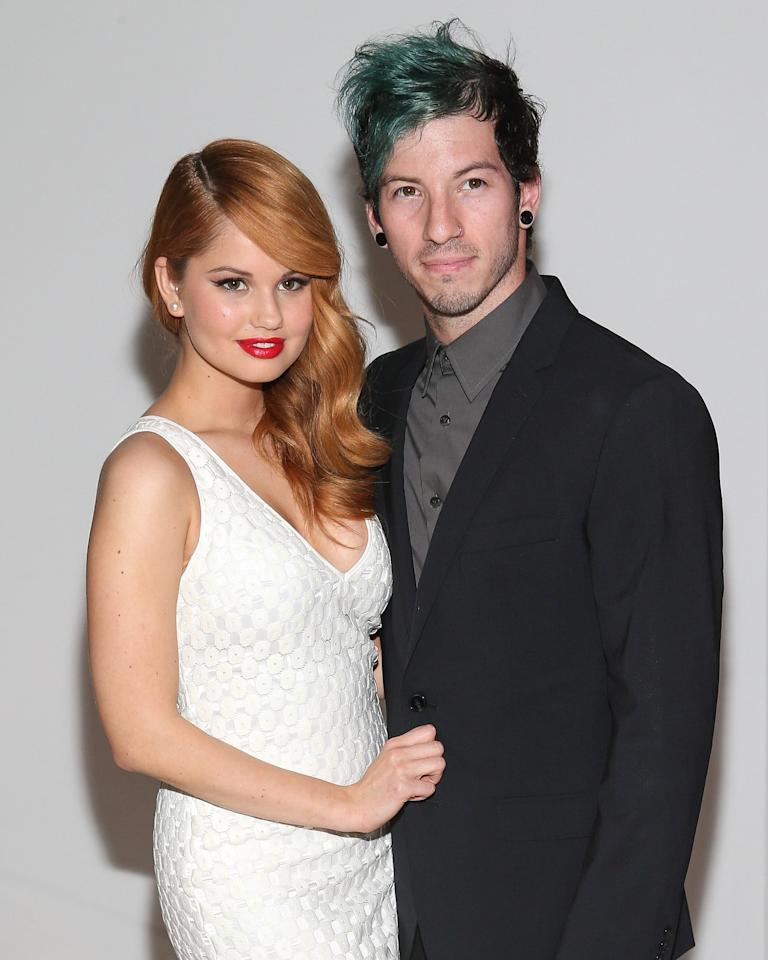 <p>About a year into their relationship, Debby and Josh made a rare joint red carpet appearance at the 2nd Annual Norma Jean Gala.</p>