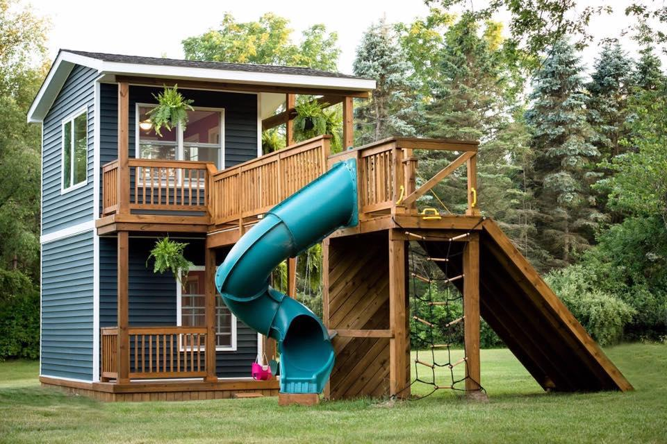 The back of the house has a slide, swing set and more. (Flashes of Life photography)