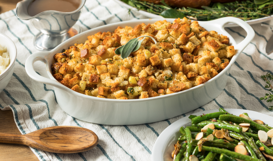 Not just for Thanksgiving, stuffing in the oven makes your holiday home smell great—and on the table is always a hit. (Photo: Getty)