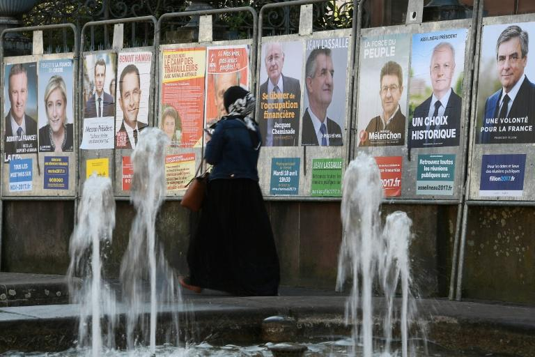 Campaign posters for the French presidential candidates cover a wall in Strasbourg, eastern France