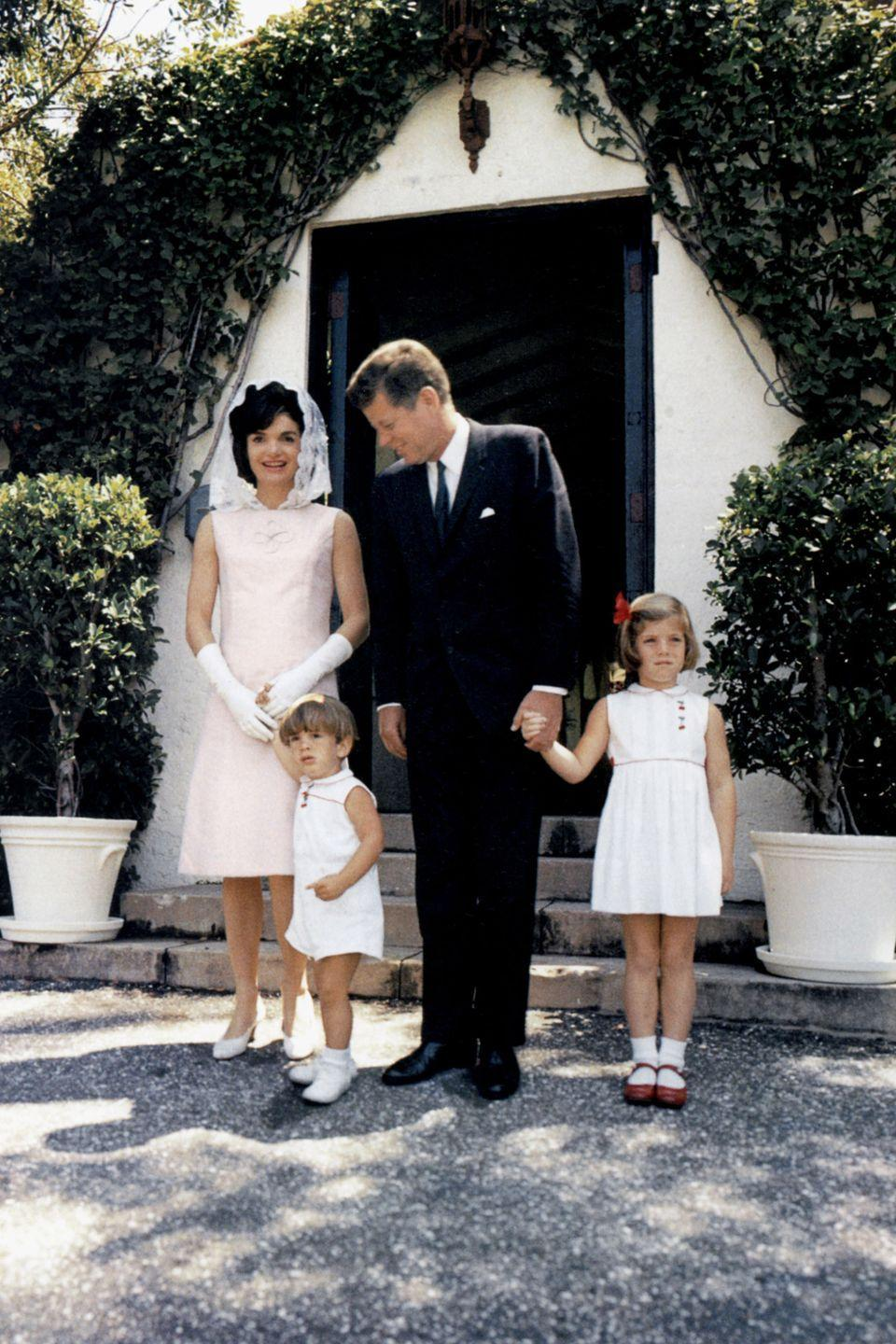 <p>The early 60s were all about Palm Springs. Here, Jackie, Caroline, John Jr. and John F. Kennedy hit the Cali hot spot in white Mommy and Me looks, save JFK in a black suit. </p>