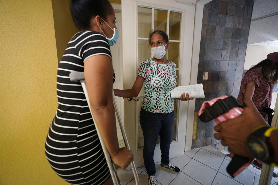 """Mileydis Tamayo, right, a nurse from Cuba who is living in Mexico while she seek asylum in the U.S., talks with Maria de Jesus Ruiz Carrasco, also an asylum seeker from Cuba who broke her leg, at a clinic in Matamoros, Mexico, Wednesday, Nov. 18, 2020. Led by U.S. military veterans, Global Response Management is staffed by volunteers primarily from the U.S. and paid asylum seekers who were medical professionals in their homelands. """"If this group wasn't here,"""" Tamayo said later. """"Many people would be in very bad shape."""" (AP Photo/Eric Gay)"""