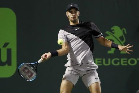 Mar 29, 2018; Key Biscayne, FL, USA; Borna Coric of Croatia hits a forehand against Alexander Zverev of Germany (not pictured) on day ten of the Miami Open at Tennis Center at Crandon Park. Mandatory Credit: Geoff Burke-USA TODAY Sports