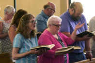 Members of Waldoboro United Methodist Church sing a hymn, Sunday, June 20, 2021, in Waldoboro, Maine. The combination of a dwindling church population and COVID-19 reduced attendance to the point that a decision was made to close the 164-year-old church. (AP Photo/Robert F. Bukaty)