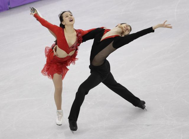<p>Yura Min and Alexander Gamelin of South Korea perform during the ice dance short dance team event in the Gangneung Ice Arena at the 2018 Winter Olympics in Gangneung, South Korea, Sunday, Feb. 11, 2018. (AP Photo/David J. Phillip) </p>