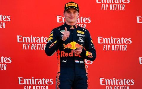 Red Bull Racing's Belgian driver Max Verstappen gives thumbs-up on the podium after finishing third in the Spanish Formula One Grand Prix at the Circuit de Catalunya in Montmelo in the outskirts of Barcelona on May 12, 2019 - Credit: AFP