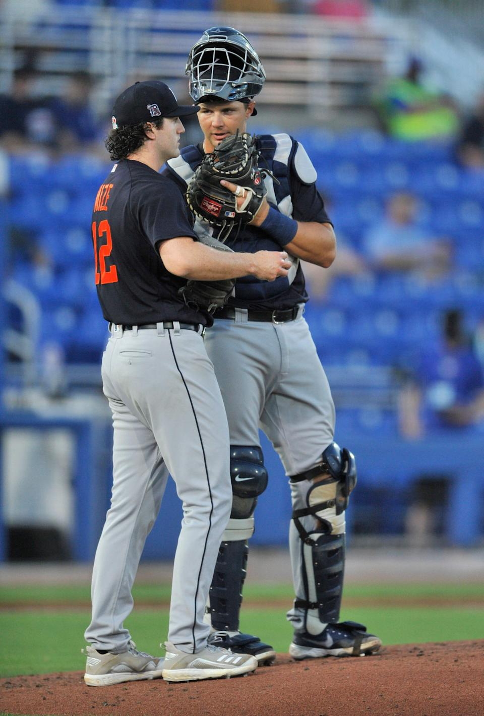 Detroit Tigers catcher Grayson Greiner, right, talks with pitcher Casey Mize during the third inning of the team's spring training baseball game against the Toronto Blue Jays in Dunedin, Fla., Thursday, March 25, 2021. (Steve Nesius/The Canadian Press via AP)