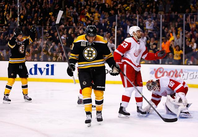 BOSTON, MA - APRIL 26: Milan Lucic #17 of the Boston Bruins celebrates his goal past Jonas Gustavsson #50 of the Detroit Red Wings in the third period in Game Five of the First Round of the 2014 NHL Stanley Cup Playoffs at TD Garden on April 26, 2014 in Boston, Massachusetts. (Photo by Jared Wickerham) (Photo by Jared Wickerham/Getty Images)