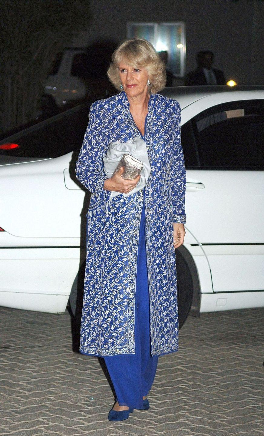 <p>On a visit to Kuwait, Camilla attended a dinner with Prince Charles wearing this embroidered and beaded royal blue coatdress with matching trousers and sapphire earrings. </p>