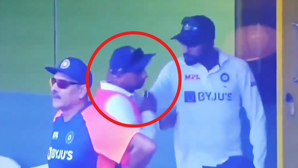 Mohammed Siraj (pictured right) grabbing Kuldeep Yadav (pictured middle) by the neck in the stands.