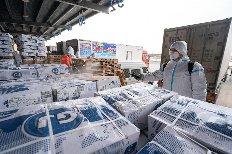 WUHAN, Jan. 7, 2021 -- A staff member sprays disinfectant on the package of imported cold chain food at a regional cold chain center in Wuhan, capital of central China's Hubei Province, Jan. 7, 2021. (Photo by Xiong Qi/Xinhua via Getty) (Xinhua/Xiong Qi via Getty Images)