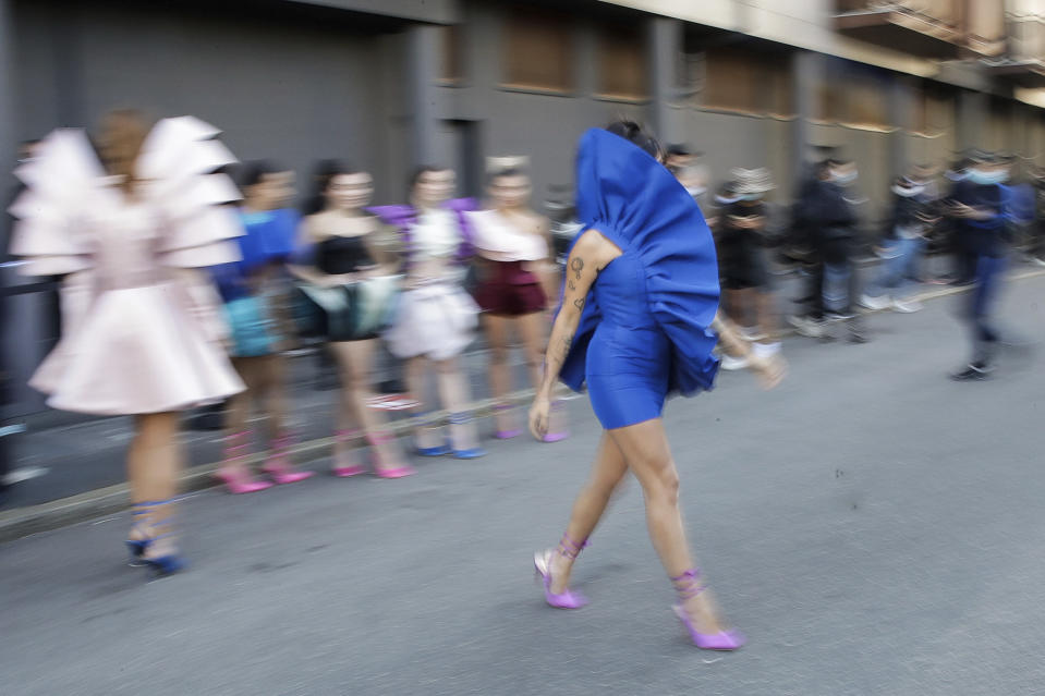 Fashion student Nora Bourelly shows her creation outside Valentino women's Spring-Summer 2021 fashion show location, in Milan, Italy, Sunday, Sept. 27, 2020. (AP Photo/Luca Bruno).