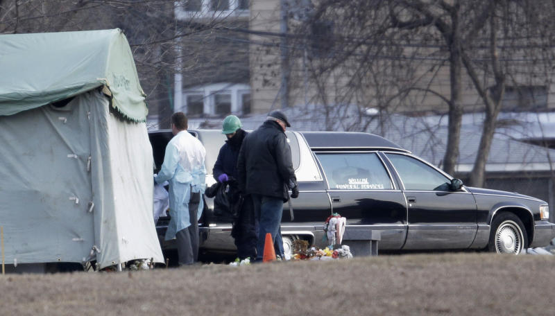 Workers at Rosehill Cemetery in Chicago on Friday, Jan. 18, 2013, place the body of Urooj Khan into a hearse after it was exhumed for an autopsy to help solve the mystery surrounding his death. Khan, 46, who was poisoned with cyanide after winning the lottery, died in July as he was about to collect $425,000 in winnings. His death was initially ruled a result of natural causes, but a relative pressed for a deeper look and his death was reclassified as a homicide.  (AP Photo/M. Spencer Green)