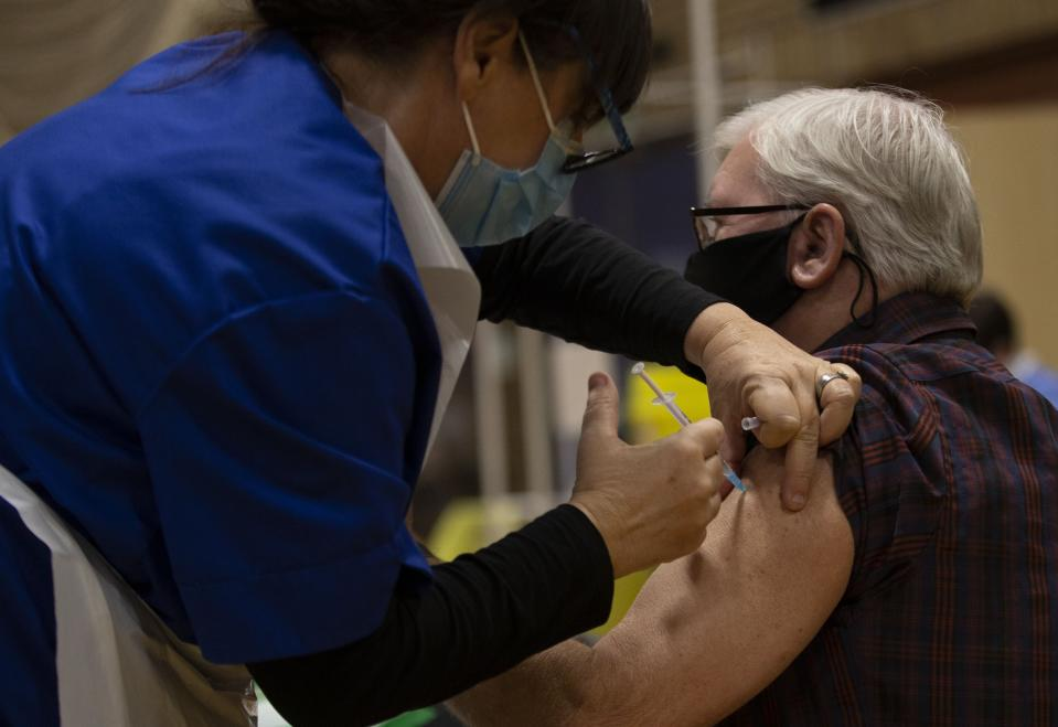NEWBRIDGE, WALES - FEBRUARY 02: A nurse administers the Psizer Biontech Vaccine to a lady on February 02, 2021 in Newbridge, Wales. As of Sunday, more than 400,000 people in Wales had had their first jab, or about 13% of Wales' population. (Photo by Huw Fairclough/Getty Images)