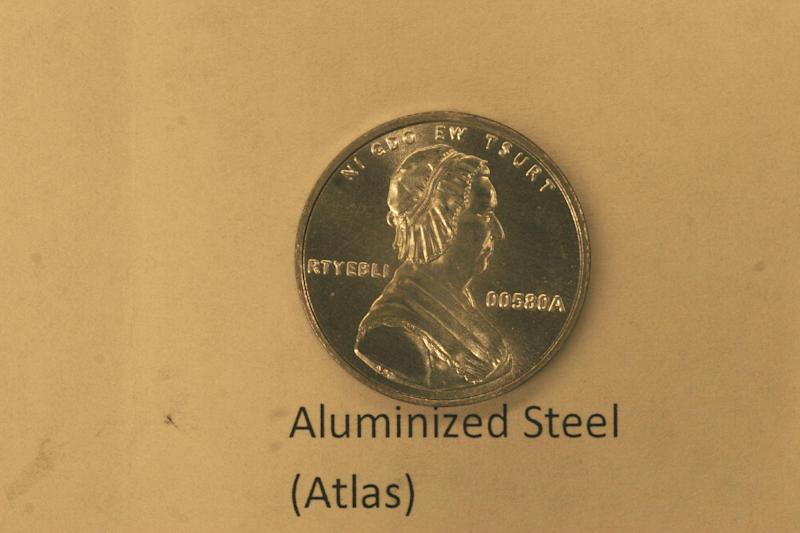 This undated photo provided on Wednesday, Dec. 19, 2012 by the U.S. Mint in Philadelphia shows is a bonneted Martha Washington on a nonsense test piece.  The Mint has been testing different materials to find less expensive ways to make coins. (AP Photo/U.S. Mint)
