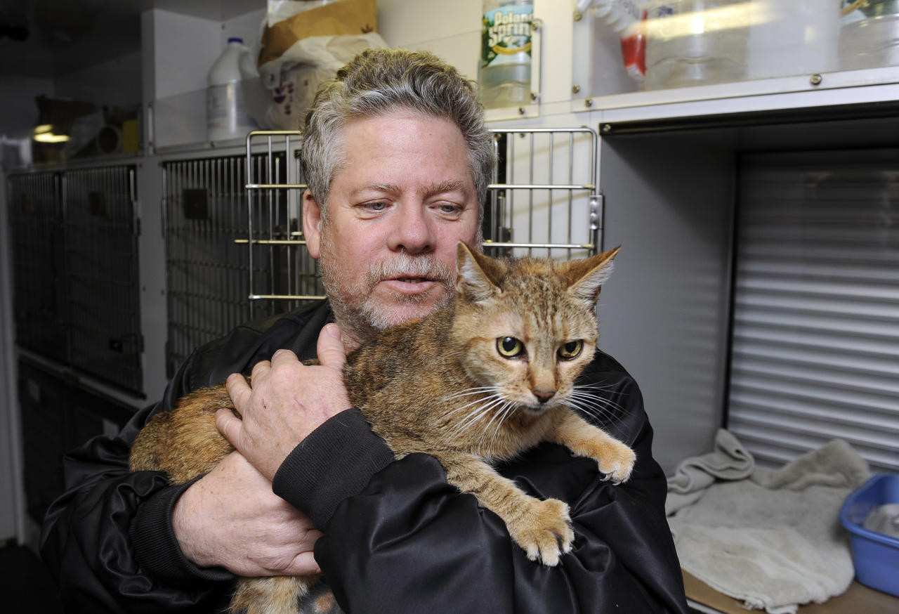 Bill Ryan, of Inwood, N.Y., comforts his cat Amy before leaving her at a pet shelter at Mitchell Park's Field House, run by the Nassau County Office of Emergency Management and Pet Safe Coalition on Sunday, Oct., 28, 2012, in Uniondale, N.Y. Pet owners could drop of their pets at the shelter and afterwards seek shelter for themselves. before the arrival of Hurricane Sandy. Ryan planned to stay at Nassau Community College, one of numerous shelters throughout Nassau County. (AP Photo/Kathy Kmonicek)