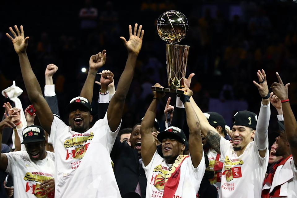 OAKLAND, CALIFORNIA - JUNE 13:  The Toronto Raptors celebrate with the Larry O'Brien Championship Trophy after their team defeated the Golden State Warriors to win Game Six of the 2019 NBA Finals at ORACLE Arena on June 13, 2019 in Oakland, California. NOTE TO USER: User expressly acknowledges and agrees that, by downloading and or using this photograph, User is consenting to the terms and conditions of the Getty Images License Agreement. (Photo by Ezra Shaw/Getty Images)
