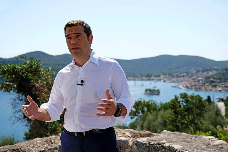"""A handout picture made available by the office of Greek Prime Minister Alexis Tsipras shows him addressing the nation from Ithaca, the home island of Homer's hero Ulysses, as he hailed the  end of his country's eight-year """"Odyssey"""" of painful bailouts"""