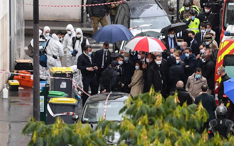 French Prime Minister Jean Castex (C), French Interior minister Gerald Darmanin (C-L) and the Mayor of Paris Anne Hidalgo (C-R) arrive at the scene - ALAIN JOCARD/AFP
