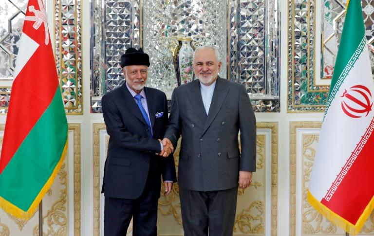 Iran's Foreign Minister Mohammad Javad Zarif (R) welcomes Oman's Minister of State for Foreign Affairs Yusuf bin Alawi bin Abdullah in Tehran