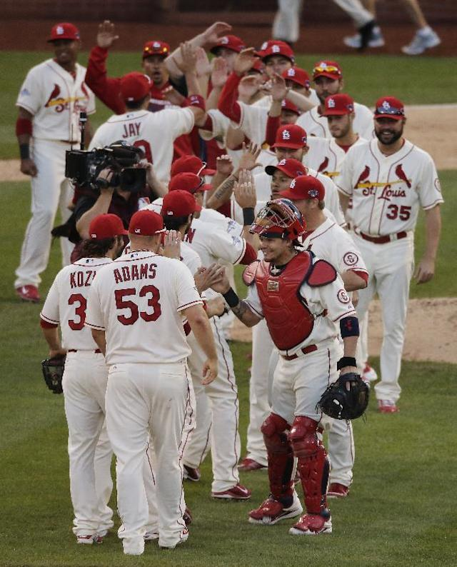 The St. Louis Cardinals celebrate after Game 2 of the National League baseball championship series against the Los Angeles Dodgers Saturday, Oct. 12, 2013, in St. Louis. Cardinals won 1-0 to take a 2-0 lead in the series. (AP Photo/Chris Carlson)