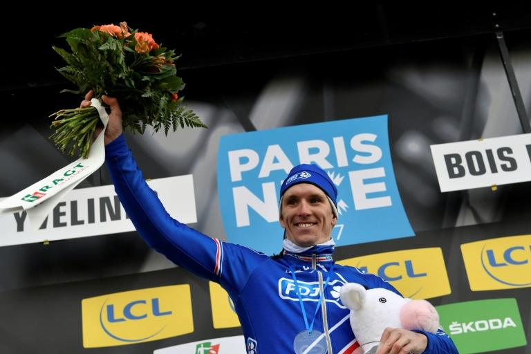 France's Arnaud Demare celebrates on the podium after winning the first stage of the Paris-Nice cycling race on March 5, 2017