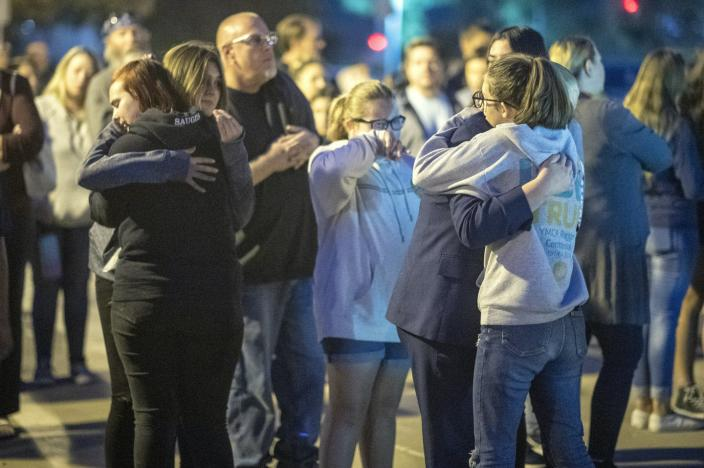 "<span class=""caption"">People hold a vigil for the victims of the Saugus High School shooting in Santa Clarita, California, in 2019. </span> <span class=""attribution""><a class=""link rapid-noclick-resp"" href=""https://www.gettyimages.com/detail/news-photo/people-effected-by-the-saugus-high-school-shoot-hold-a-news-photo/1187735941?adppopup=true"" rel=""nofollow noopener"" target=""_blank"" data-ylk=""slk:Hans Gutknecht/MediaNews Group/Los Angeles Daily News via Getty Images""> Hans Gutknecht/MediaNews Group/Los Angeles Daily News via Getty Images</a></span>"