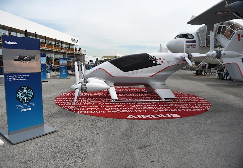 The Vahana is Airbus's single-seat prototype all-electric, tilt-wing aircraft to provide personal mobility services in urban areas vehicle is presented on the Airbus static display at the International Paris Air Show on June 18, 2019 at Le Bourget Airport, near Paris. (AFP Photo/ERIC PIERMONT)