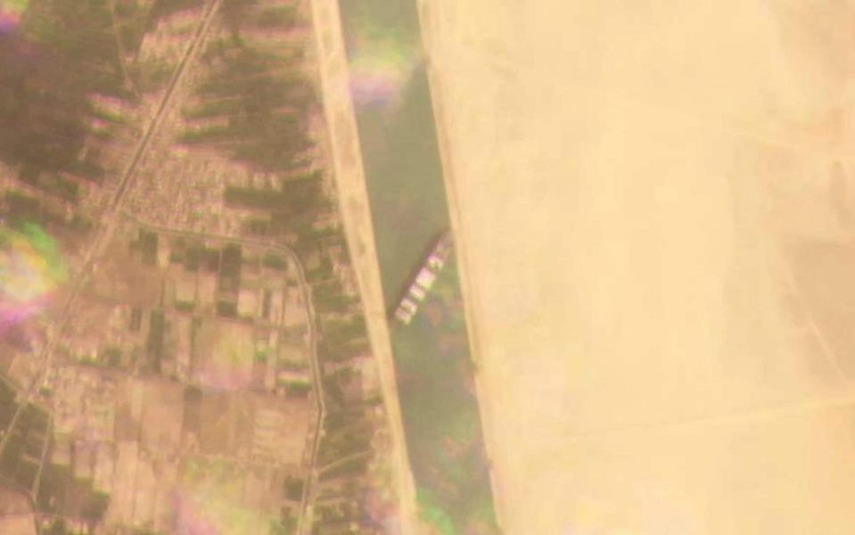 A satellite image shows the stuck cargo ship - Planet Labs Inc. via AP