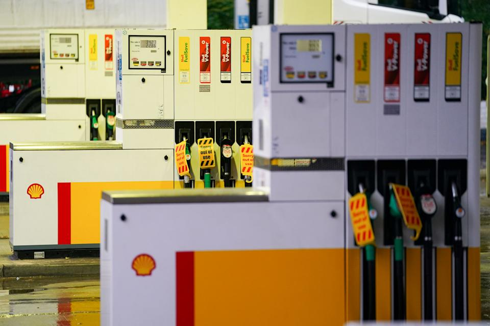 Fuel pumps out of use at a deserted Shell petrol station forecourt in Warwick. Picture date: Monday September 27, 2021.