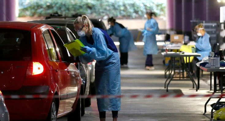 Medical practitioners take information from members of the public at a drive through testing clinic in the carpark of Victoria Gardens Shopping Centre on May 05, 2020 in Melbourne, Australia.