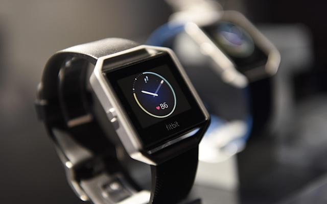 Fitbit devices, for example, are end-to-end encrypted, meaning data is scrambled - © 2016 Bloomberg Finance LP
