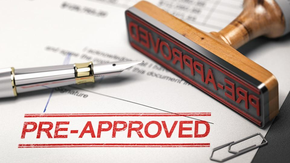 Printed document with rubber stamp and the word pre-approved.