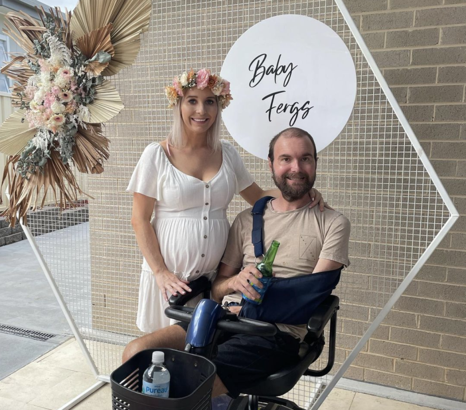 Jaymie, left, and husband Scott Ferguson in a wheelchair ahead of the birth of their daughter.