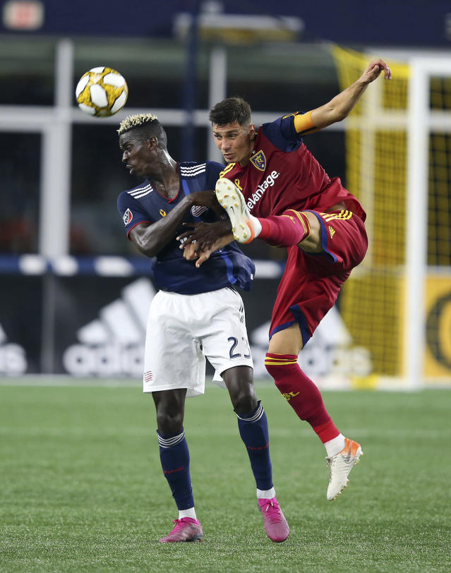 Real Salt Lake midfielder Damir Kreilach, right, deflects the ball past New England Revolution midfielder Wilfried Zahibo (23) during the second half of an MLS soccer match at Gillette Stadium, Saturday, Sept. 21, 2019, in Foxborough, Mass. (AP Photo/Stew Milne)
