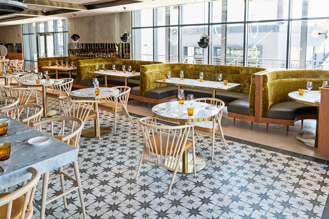 """<p><strong>First impression?</strong><br> Look no further than Officina's chic rooftop, dubbed Terrazza, for proof that Washingtonians are seriously spoiled these days when it comes to dining out. Gather around a firepit and grab a patio chair, then take in the waterfront view—and the scene—at the three-level Italian restaurant with lovely planter gardens, a wooden deck, dramatic light fixtures, and a tiled bar. Somehow it all looks even better at night—and heaters make it a worthy destination year-round.</p> <p><strong>So who's there?</strong><br> Coworkers flock here starting at 4 p.m. on weekdays, and it's a scene on the weekends.</p> <p><strong>How are the drinks?</strong><br> A spritz is a given; in addition to Aperol, there's a house version made with grapefruit and Sicilian wine. Groups can splurge on a $175 Nectar of the Gods Champagne and a large-format vodka cocktail that serves eight. You can't go wrong with a glass or bottle of wine sourced from Puglia, Umbria, and other regions of Italy.</p> <p><strong>Worth ordering something to eat, too?</strong><br> Officina is the brainchild of Michelin-starred chef and owner Nicholas Stefanelli, of <a href=""""https://www.cntraveler.com/restaurants/washington-d-c/masseria?mbid=synd_yahoo_rss"""">Masseria</a>, who dreamed of creating multiple venues within one set of walls. The casual menu on the rooftop includes fried snacks like arancini and crispy calamari, along with veal meatballs, and extensive Italian cheeses and cured meats. Order Roman-style pizzas, topped with prosciutto or wild mushrooms, by the half or whole.</p> <p><strong>Did the staff do you right?</strong><br> They're friendly and good at directing traffic.</p> <p><strong>Wrap it up: how can we make the most of a visit?</strong><br> Come for al fresco birthday drinks.</p>"""