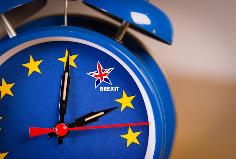 """A clock in the colors of the European flag with the minute hand moving toward a star in the colors of the Union Jack, which is labeled """"Brexit"""""""