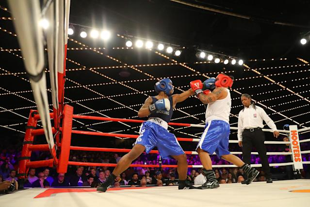 <p>Reshawn Merrick (blue) lands a punch on John Chalen (red) in the Bronx Precinct Callout during the NYPD Boxing Championships at the Hulu Theater at Madison Square Garden on March 15, 2018. (Gordon Donovan/Yahoo News) </p>