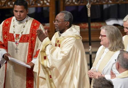 The Reverend Curry acknowledges applause after delivering his sermon and his Installation ceremony, at the Washington National Cathedral, in Washington