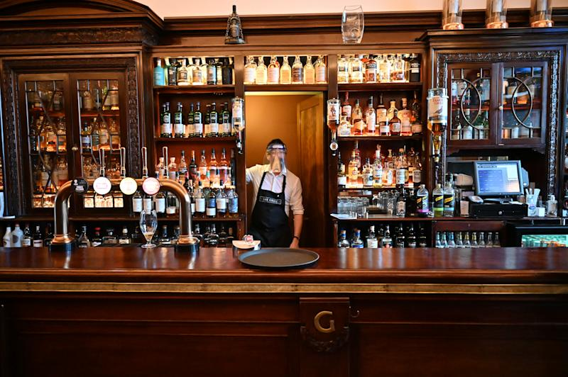 ABERDEEN, SCOTLAND - AUGUST 05: Kieth McKenzie wears a shielding face mask as he works in the pub The Grill in Union Street on August 5, 2020 in Aberdeen, Scotland. Scotland's First Minister Nicola Sturgeon acted swiftly and put Aberdeen back into lockdown after cases of Coronavirus in the city doubled in a day to 54. She ordered all indoor and outdoor hospitality venues to close by 5pm. (Photo by Jeff J Mitchell/Getty Images)