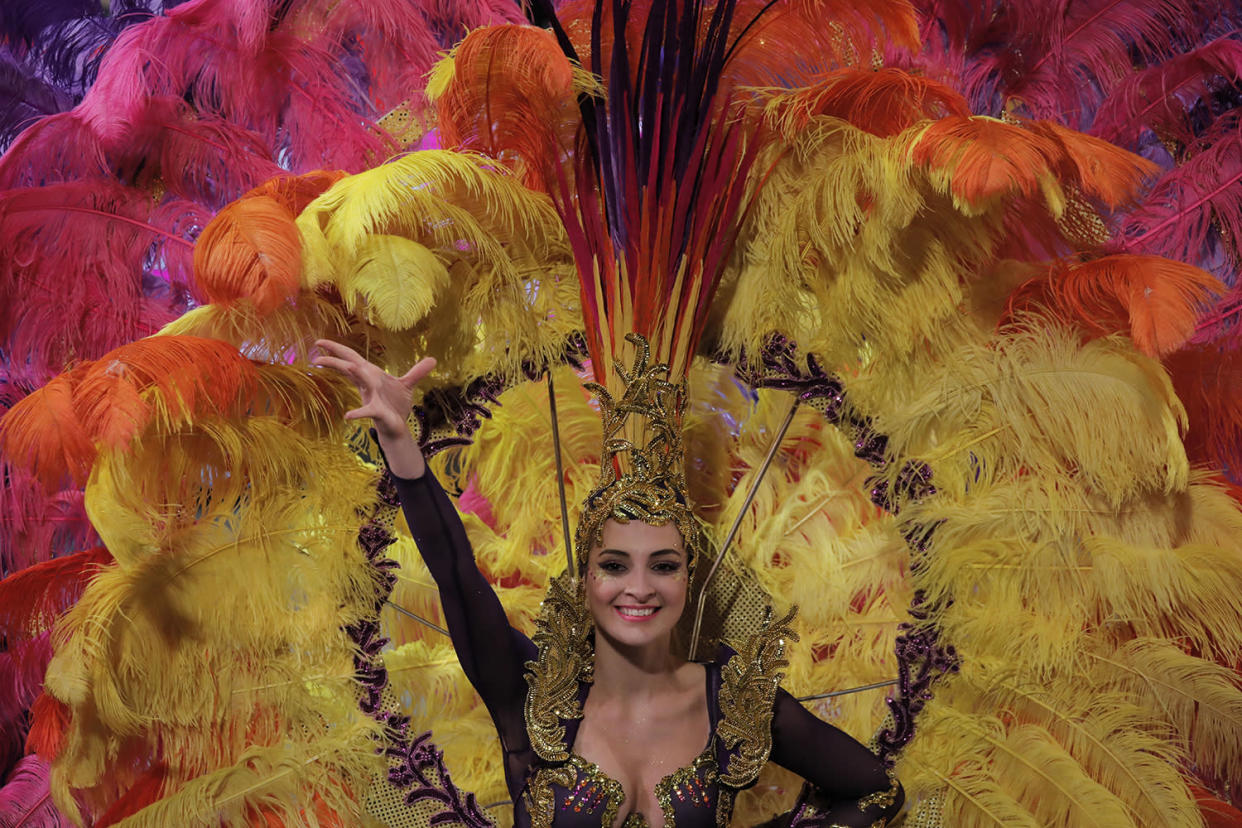 A performer takes part in a night parade to celebrate Chinese New Year in Hong Kong, Saturday, Jan. 28, 2017. The Lunar New Year this year marks the Year of the Rooster in the Chinese calendar. (AP Photo/Vincent Yu)