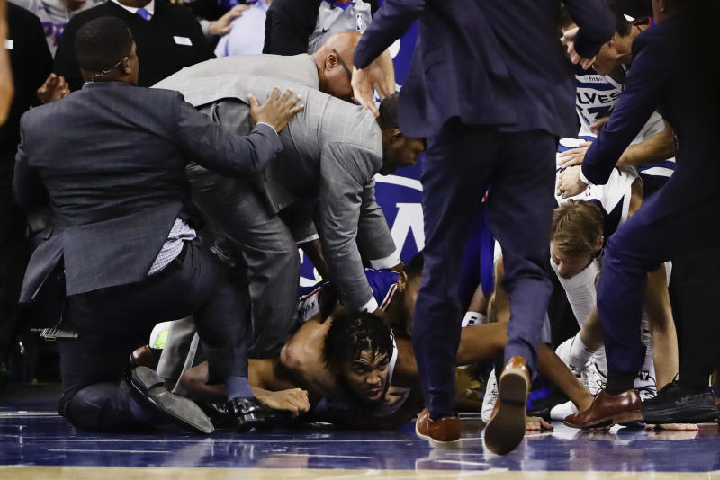 Minnesota Timberwolves' Karl-Anthony Towns lies on the court after an altercation with Philadelphia 76ers' Joel Embiid during the second half of an NBA basketball game Wednesday, Oct. 30, 2019, in Philadelphia. Both players were ejected. The 76ers won 117-95. (AP Photo/Matt Rourke)