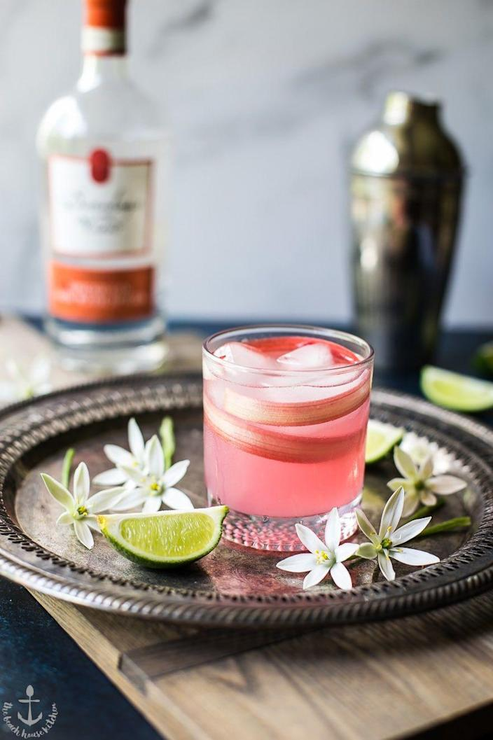 """<p>Thanks to a sliver of rhubarb wrapped around the inside of the tumbler, this gin-based drink is fit for a refined celebration.</p><p>Get the <a href=""""https://thebeachhousekitchen.com/spiced-rhubarb-collins-cocktail/"""" rel=""""nofollow noopener"""" target=""""_blank"""" data-ylk=""""slk:recipe"""" class=""""link rapid-noclick-resp"""">recipe</a>. </p>"""