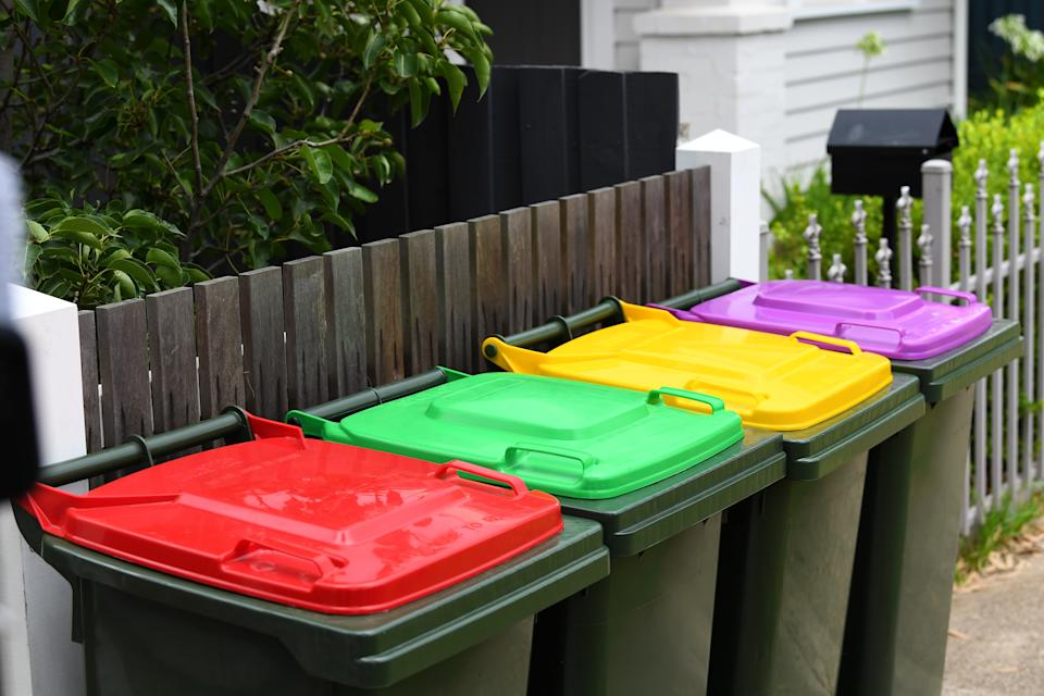 A red, yellow, green and purple bin outside a Melbourne home at Spotswood.