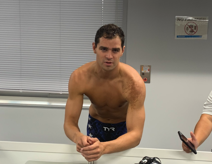 Michael Andrew, a U.S. swimming star who chose to not get vaccinated ahead of the Tokyo Games, refused to wear a mask during his last post-race interview. (Twitter/cbrennansports)