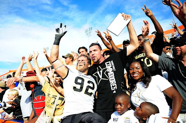 GAINESVILLE, FL - NOVEMBER 09: Kyle Woestmann #92 of the Vanderbilt Commodores celebrates with fans following a victory over the Florida Gators at Ben Hill Griffin Stadium on November 9, 2013 in Gainesville, Florida. Vanderbilt won the game 34-17. (Photo by Stacy Revere/Getty Images)