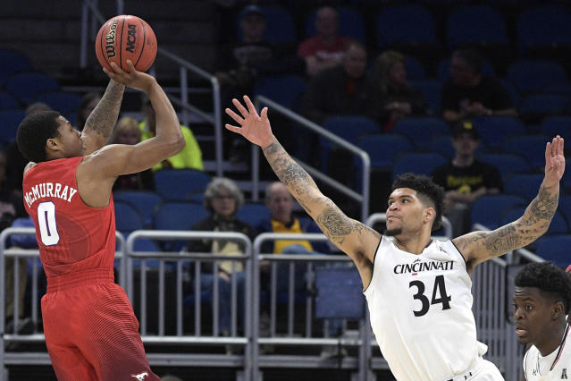 SMU guard Jahmal McMurray (0) goes up for a shot in front of Cincinnati guard Jarron Cumberland (34) during the first half of an NCAA college basketball quarterfinal game at the American Athletic Conference tournament Friday, March 9, 2018, in Orlando, Fla. (AP Photo/Phelan M. Ebenhack)