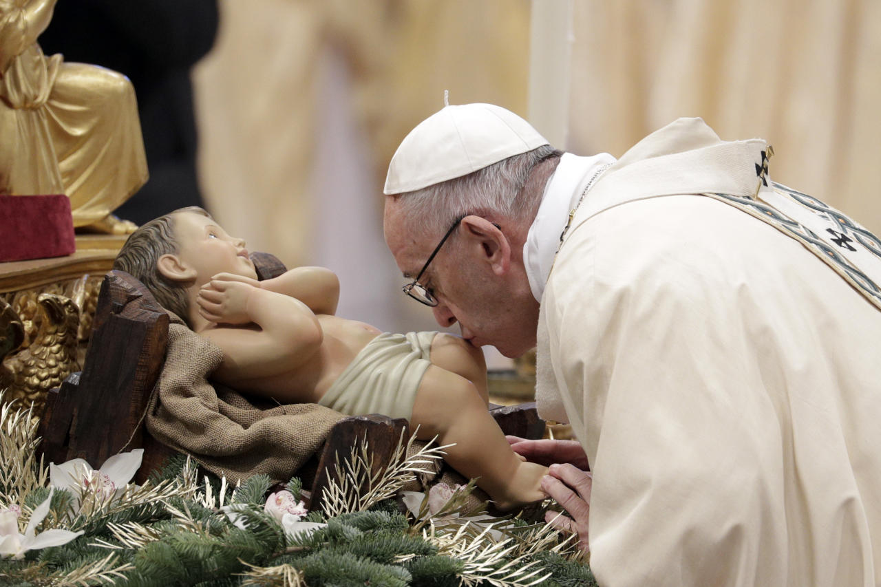 <p>Pope Francis kisses a statue of the Divine Infant as he arrives to celebrate an Epiphany Mass in St. Peter's Basilica at the Vatican, Saturday, Jan. 6, 2018. (Photo: Andrew Medichini/AP) </p>