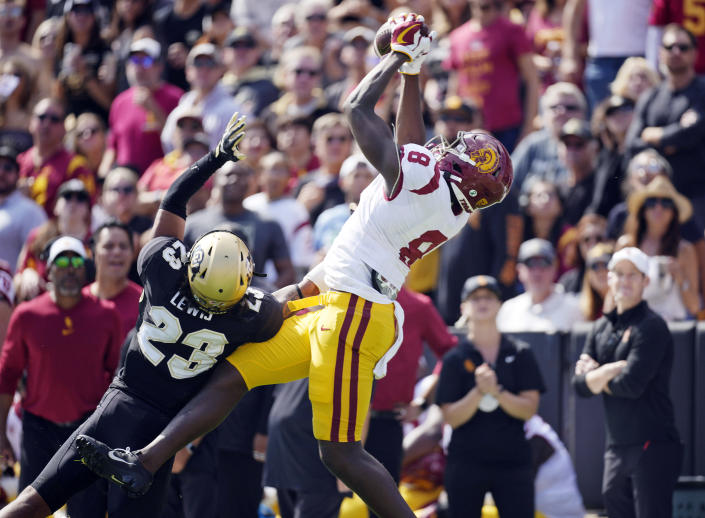 Southern California tight end Michael Trigg, right, pulls in a pass for a touchdown as Colorado safety Isaiah Lewis defends in the first half of an NCAA college football game Saturday, Oct. 2, 2021, in Boulder, Colo. (AP Photo/David Zalubowski)